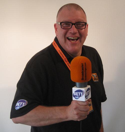 Russell-holding-BETT-Radio-.jpg